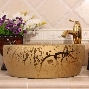 Silver and golden Ceramic washbasins