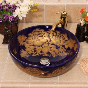 Dark blue and black with gold flower design Oval ceramic vessel sink