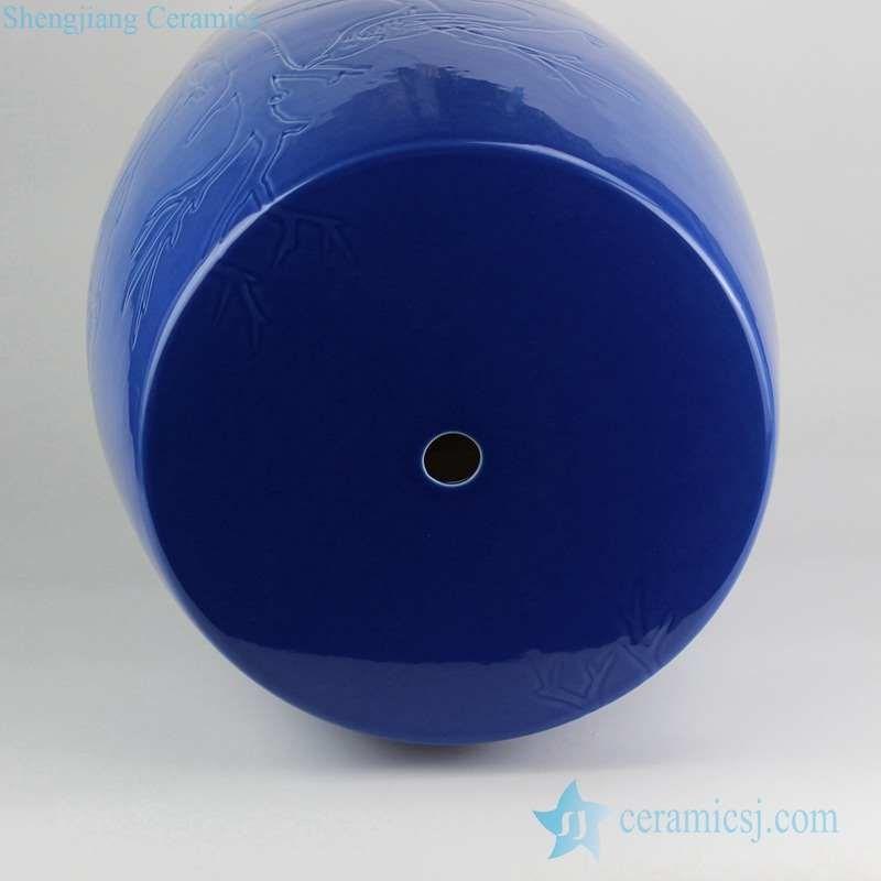 dark blue ceramic seat with bird pattern