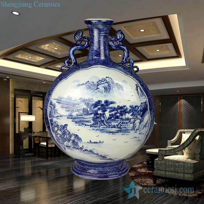Hand paint blue and white mountain and river pattern ceramic holding moon shape vase with lion lug