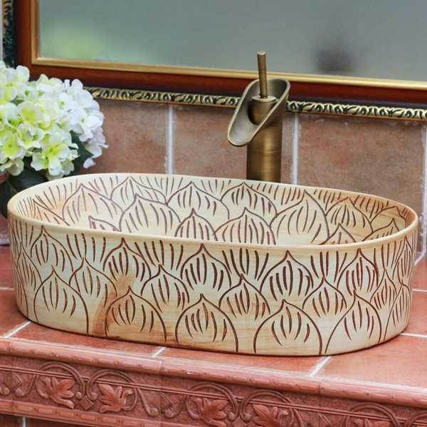 TPAA-102-w56×33×15j3135 TPAA-102 Carved lotus petal design oval clay washing basin - shengjiang  ceramic  factory   porcelain art hand basin wash sink