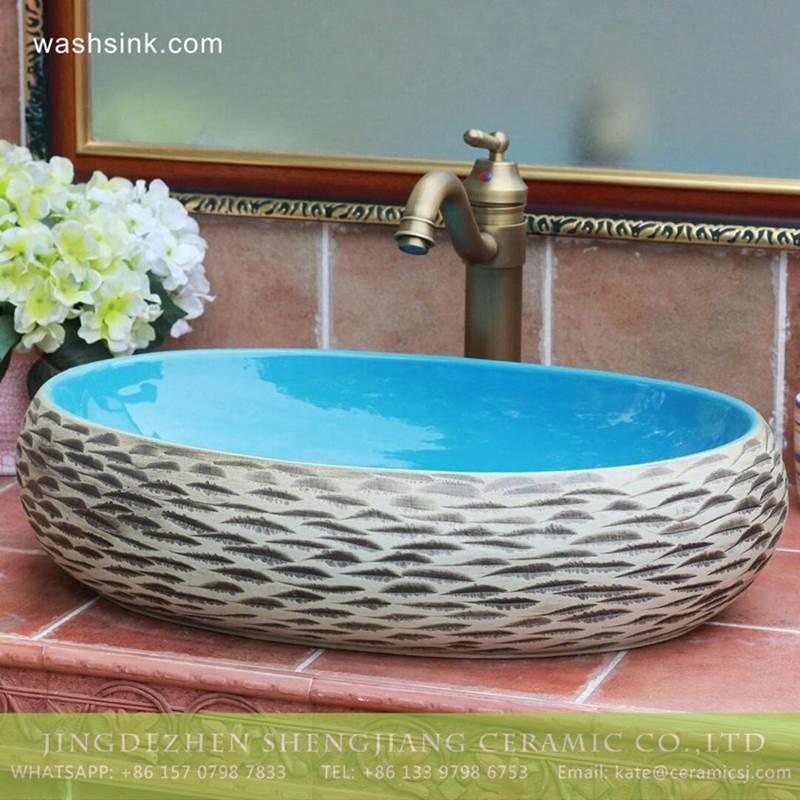 Carved style ocean blue glaze inside Jingdezhen hot sale long ceramic trough sink vanity