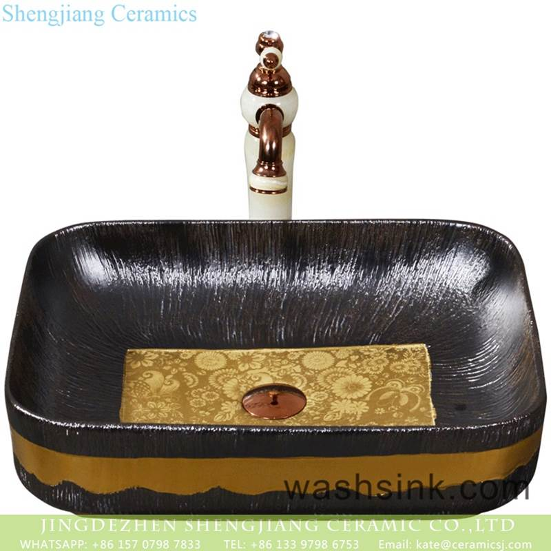 The European style of black ceramic with yellow beautiful pattern lavabo