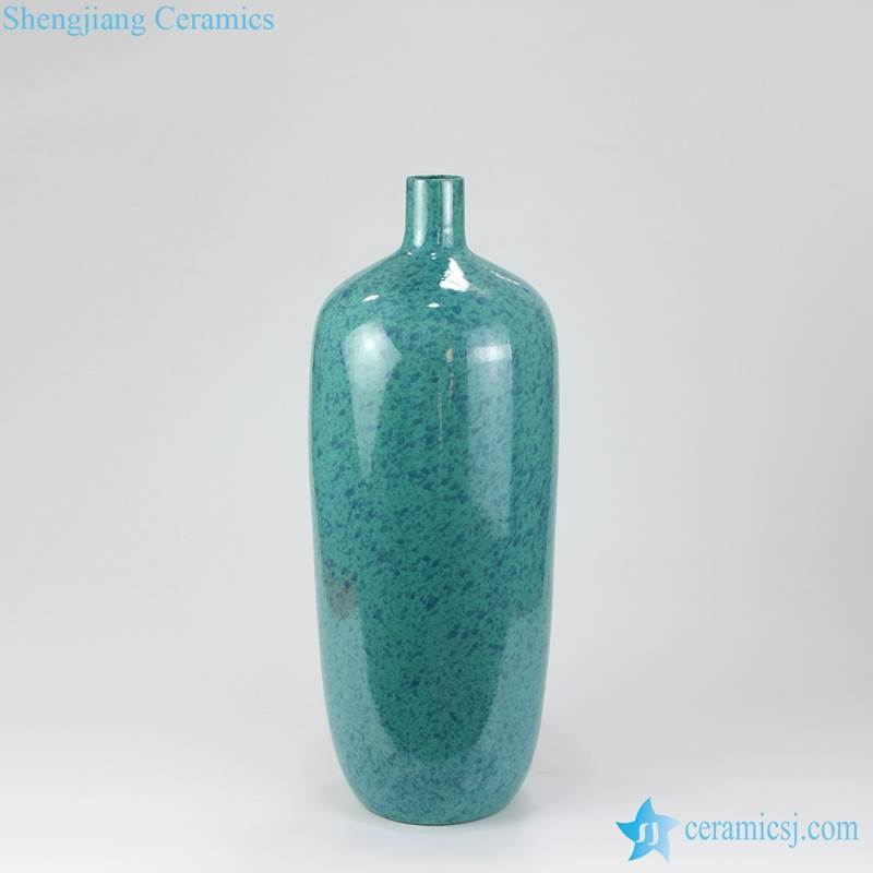 green tall ceramic vase