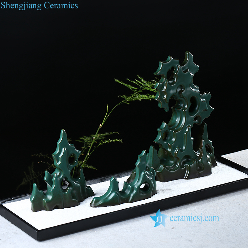 Ceramic mountain statue