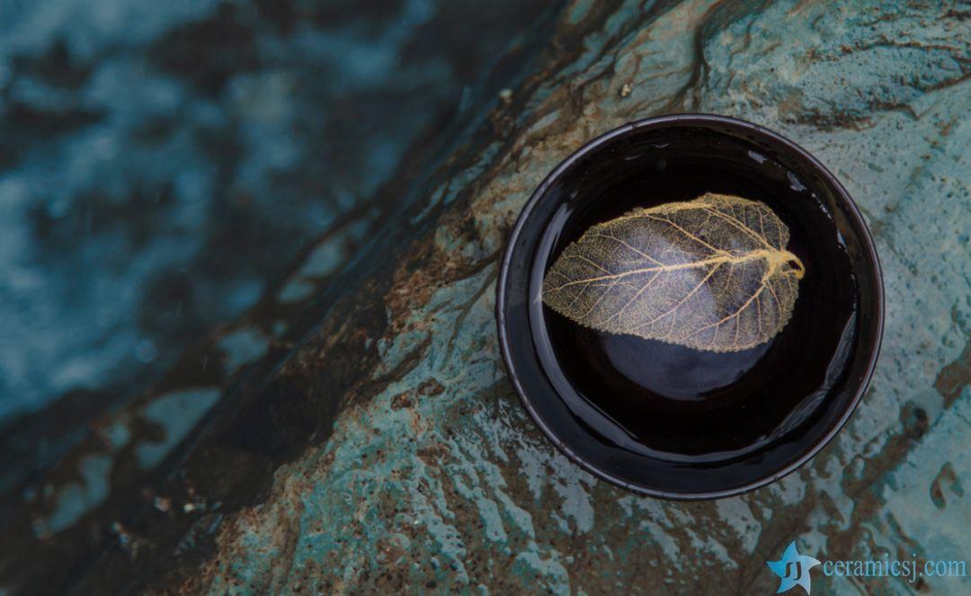 leaf inside tea cup