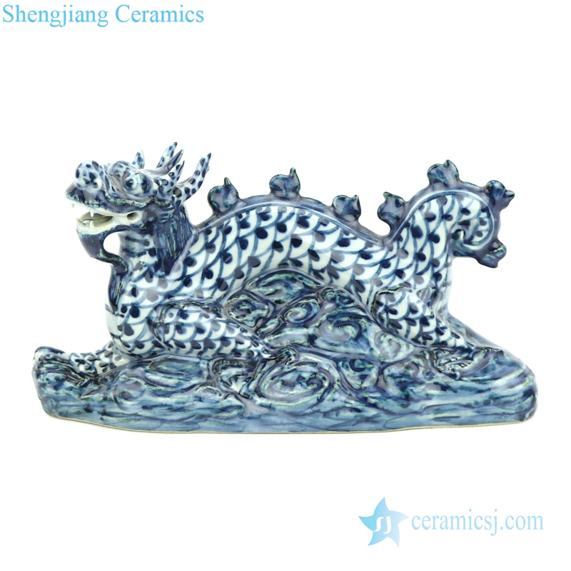 blue and white ceramic dragon statue