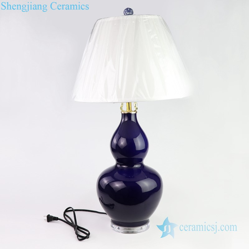 deep blue ceramic lamp with white lampshade
