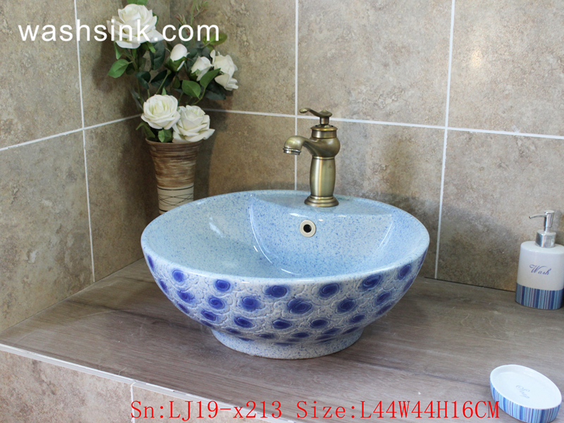 blue and white wash basin