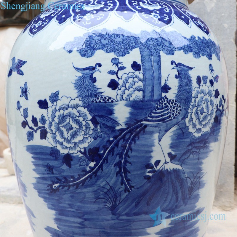 blue and white ceramic jar with lion's head shaped lid