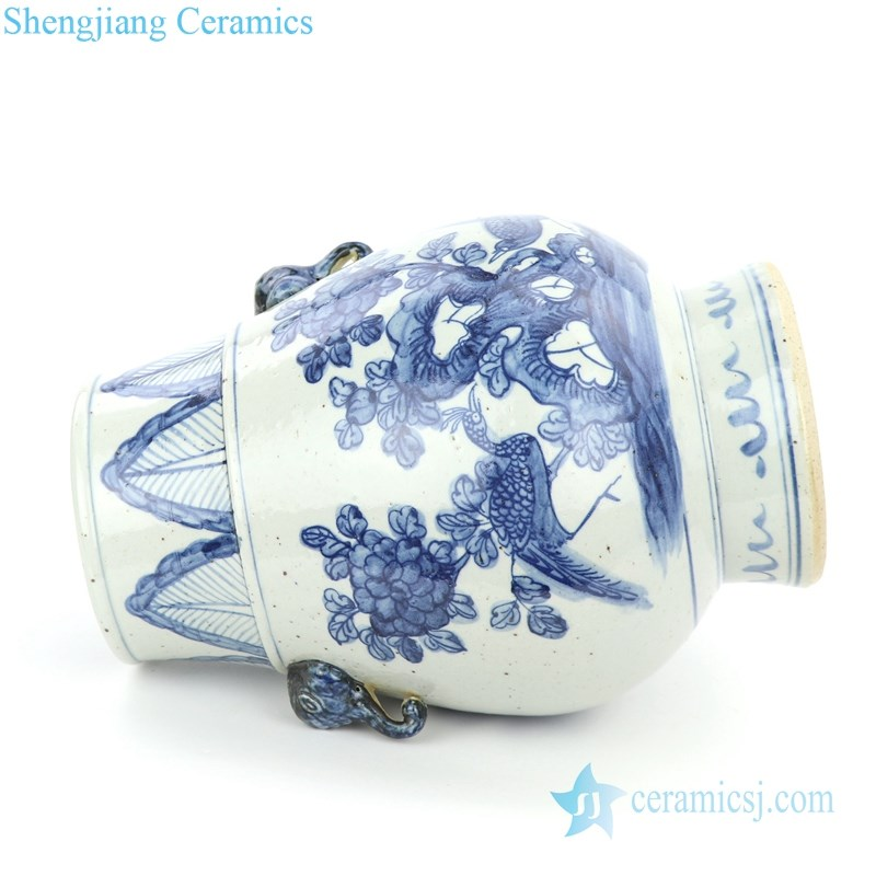blue and white ceramic with two handles jar