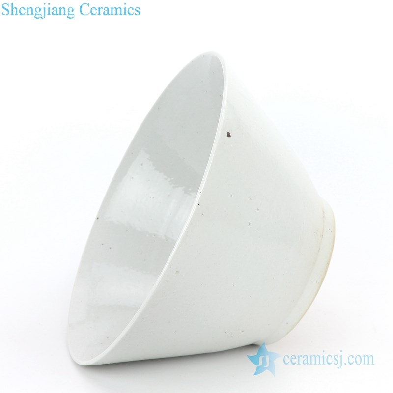 white ceramic bowl with bamboo hat shape