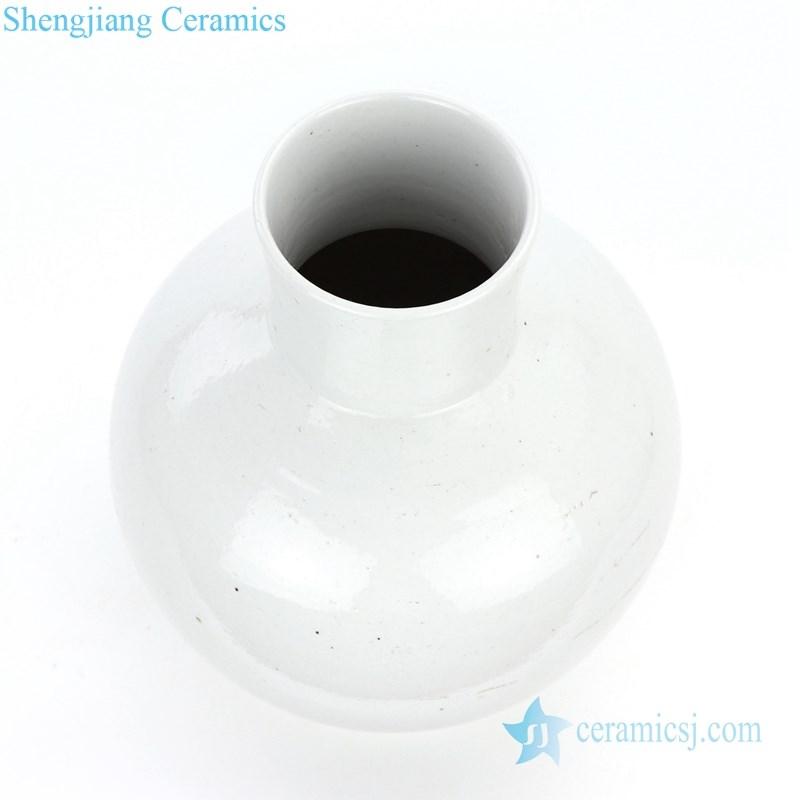 white ceramic globular vase