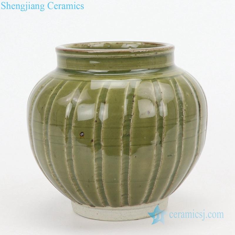 old green ceramic vase