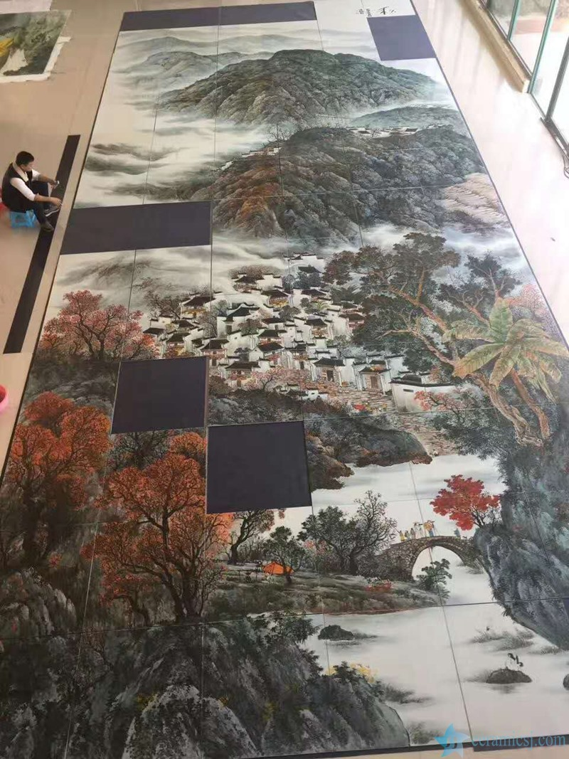 A ceramic mural is being installed for correction