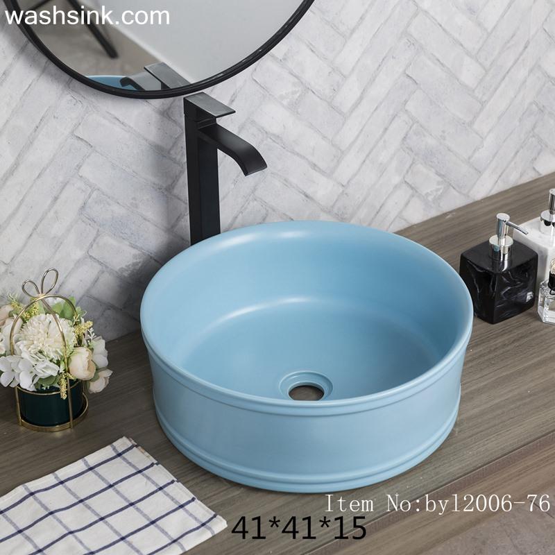 Blue glazed round ceramic wash basin