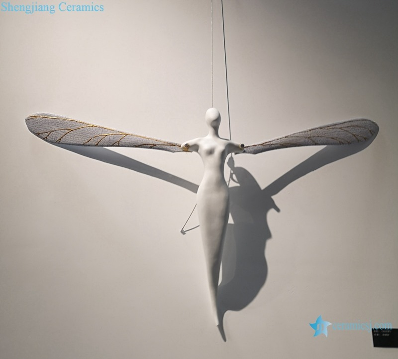 AN ANGEL WITH WINGS REGAINED DESIGN SCULPTURE